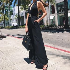 Open back deep v jumpsuit Olivia culpo